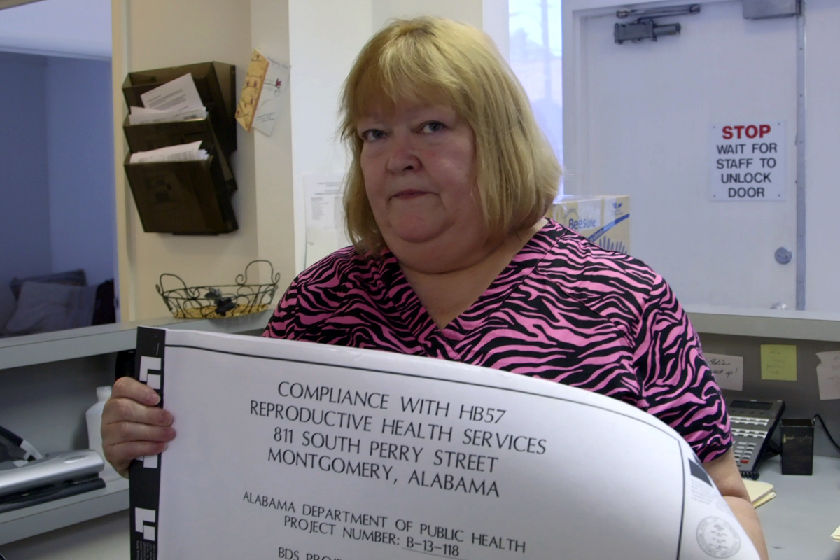 2.June Ayers, co-owner of Reproductive Health Services in Montgomery, Ala. displays blueprints for changes to her clinic that are necessary to adhere to new state guidelines.